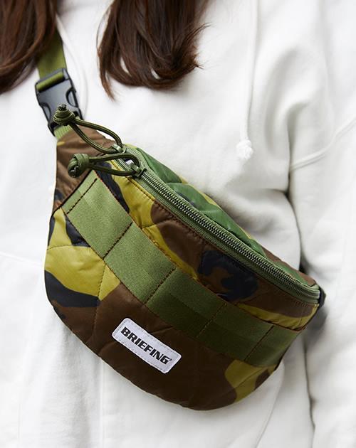 カモフラ柄のボディバッグを選んでトレンド感にアプローチ♪/></p> <p class=